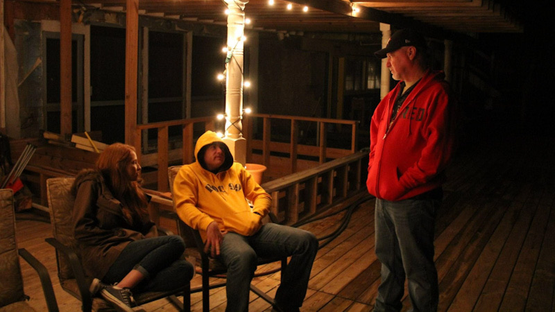 Dad, Hannah, and Tyler having a late night conversation on the porch.