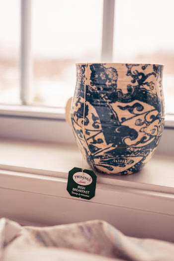 My favorite blue & white tea mug (that Bryan so graciously repaired for me) sitting on the window sill with Twining's Irish Tea steeping.