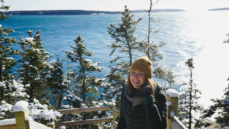 In the sun at Acadia National Park, smiling and enjoying the view shot by Claudia Bowden.