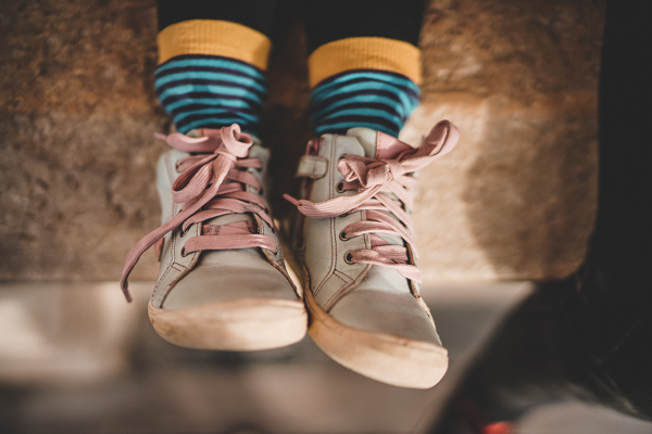 Child's rubber sneakers, Photo by Zan on Unsplash.