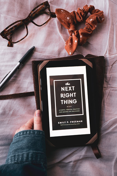 A moody themed book photo of The Next Right Thing, by Emily P Freeman
