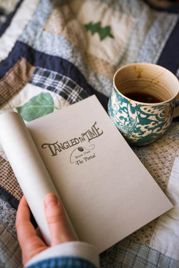 Reading Tangled in Time: The Portal while drinking some hot tea.